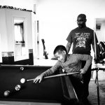 father plays pool with soon at home Northwest Philadelphia Lucy Baber Top Family Photographer