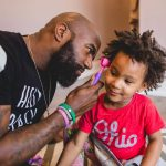 father plays with toddler child at home Society Hill Philadelphia Lucy Baber Family Photographer