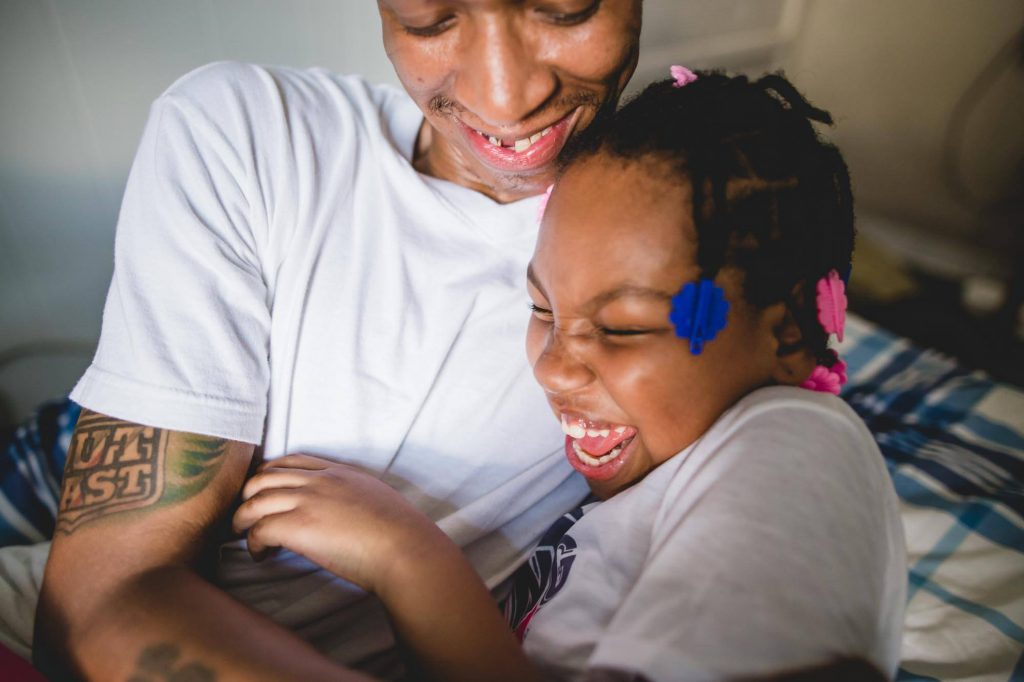father and daughter laugh together at home Northern Liberties Philadelphia Lucy Baber Photography