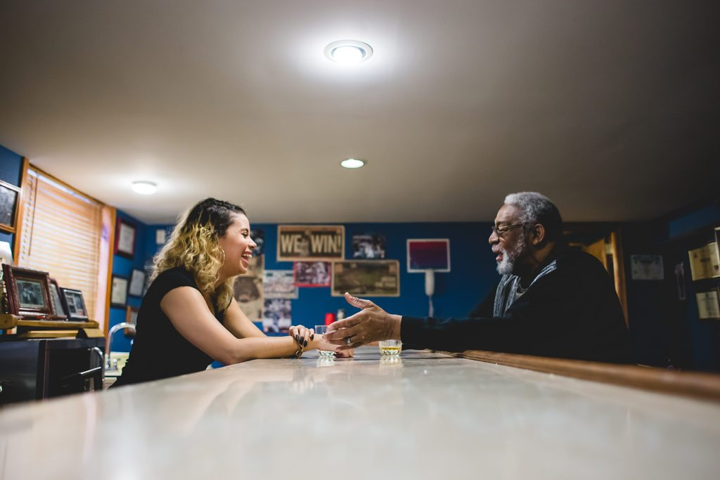 father and teenage daughter talking and laughing at home Grey's Ferry Philadelphia Lucy Baber Family Photographer