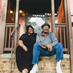 Dad sits on steps with adult daughter at home in Richmond Virginia Lucy Baber Family Photographer