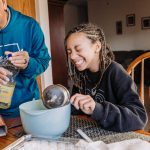 Dad and child cook and laugh together in kitchen Mt Airy Philadelphia Lucy Baber Family Photographer