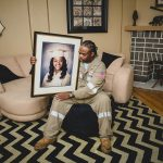 Rodney holds framed graduation photo of daughter who was killed Philadelphia Lucy Baber Family Photographer