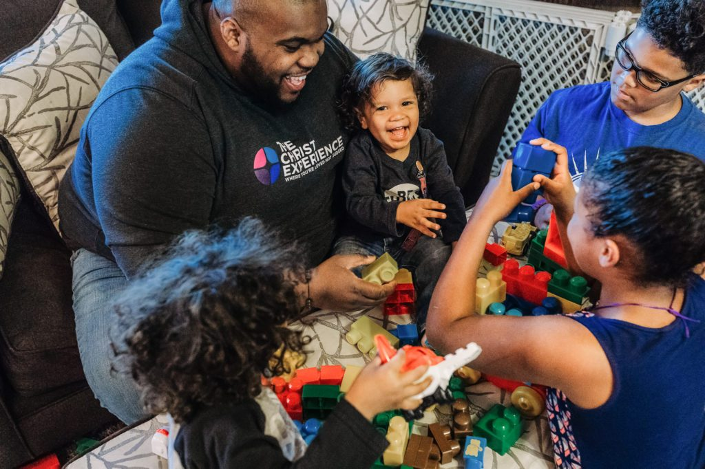 dad plays with legos with his four children at home Passyunk Philadelphia Lucy Baber Family Photographer
