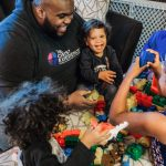 Reverend Nicholas Lee playing Legos with his four kids 100 Black Dads Philadelphia Lucy Baber Photography