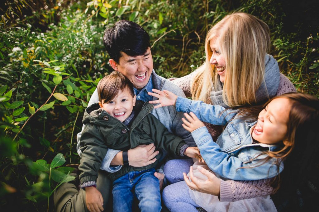 Parents with two laughing toddlers in park family photo session Northwest Philadelphia Lucy Baber Photography
