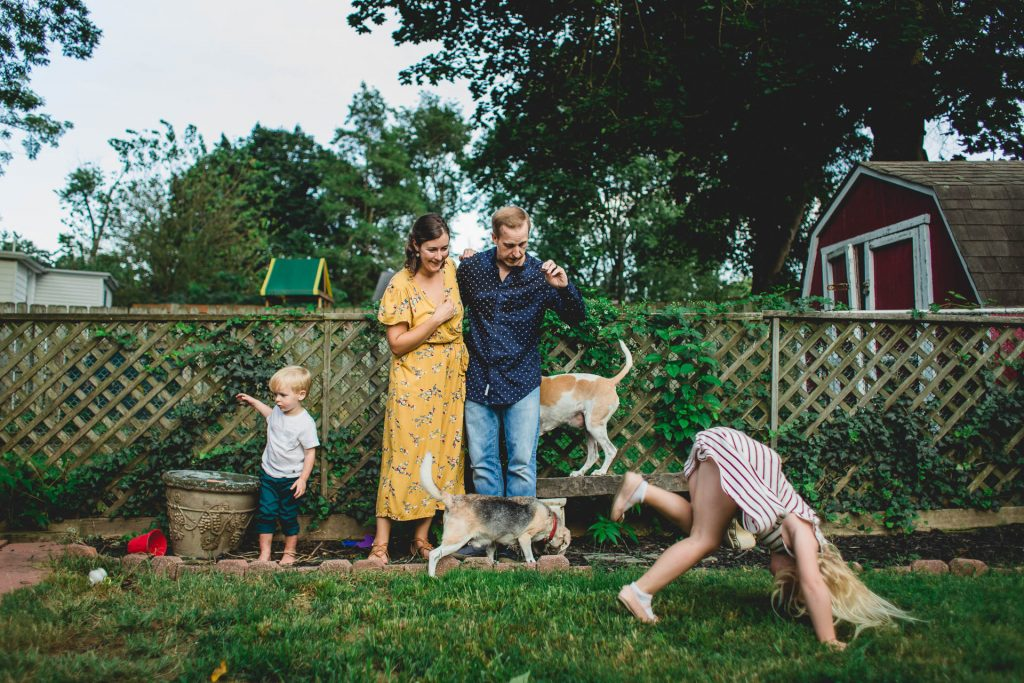 Family photo session with parents kids and dogs playing in backyard Philadelphia Lucy Baber Photography