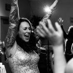 Wedding guest in sequin dress having fun on the dance floor