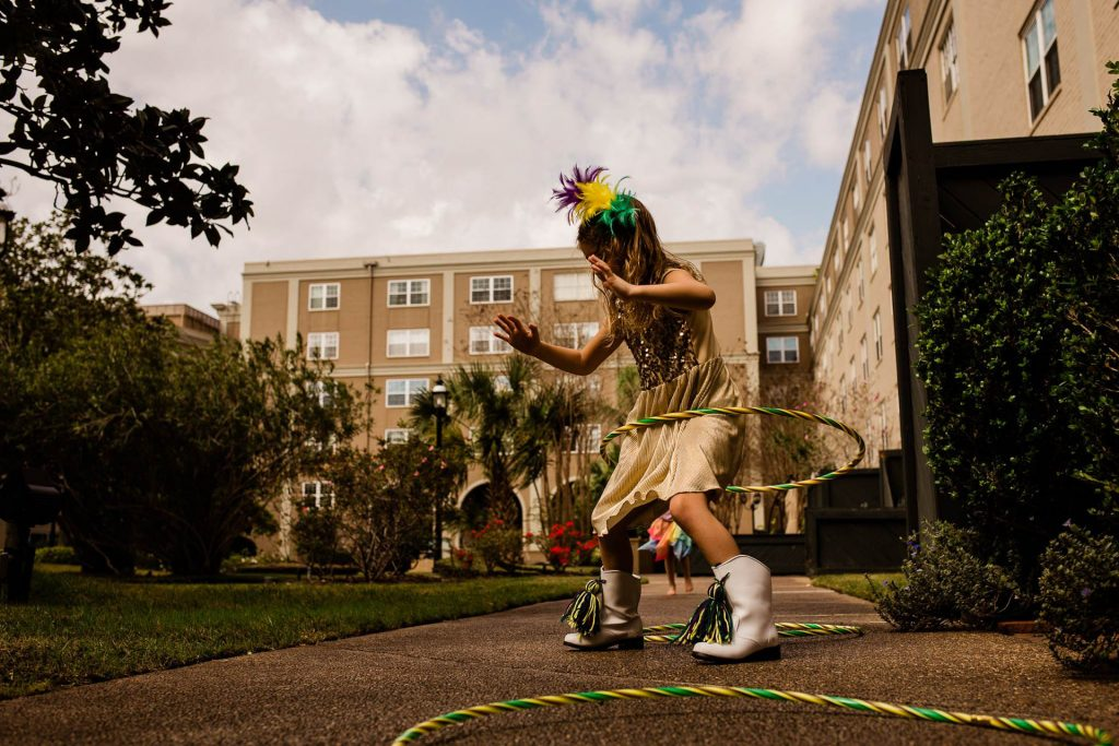 young girl playing with a hula hoop in a park Philadelphia