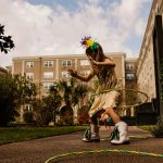 young girl plays with hula hoop outside Philadelphia PA Lucy Baber Photography