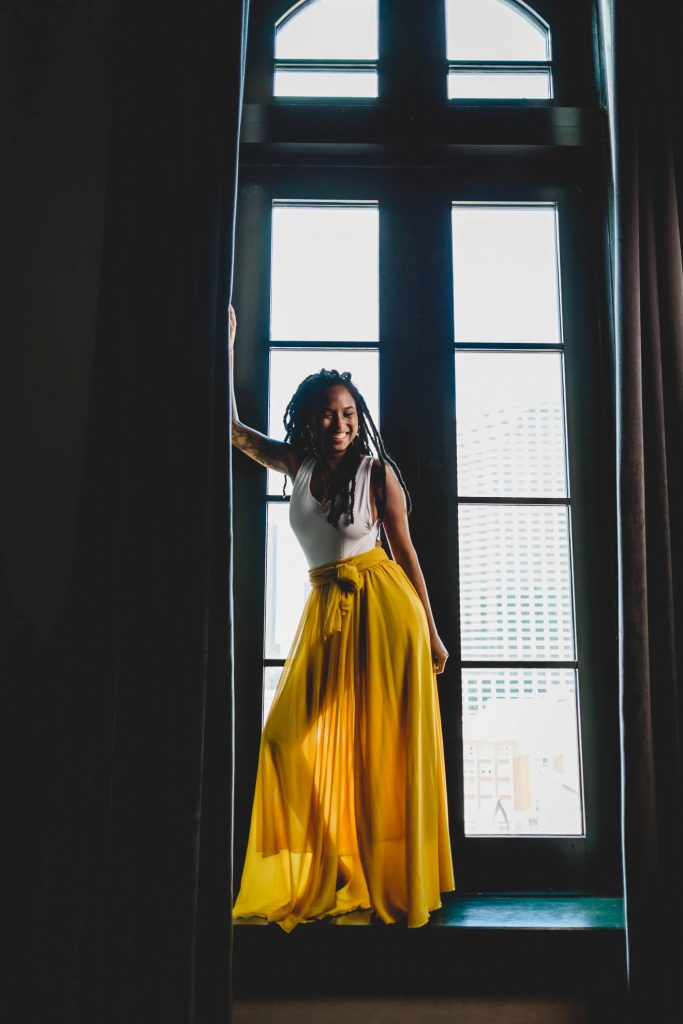 Black woman yellow skirt laughing